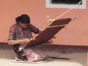 woman working with a backstrap loom in Guatemala