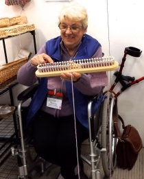 this lady is using a double sock loom to make a matching pair! www.glyn-coch.com