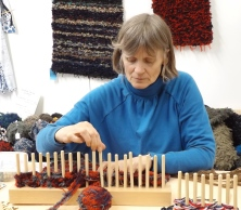 this lady not only makes these peg looms out of recycled wood, but she sells balls of tweed waste to make rugs with! facebook - waste2want
