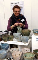 potter/knitter on her stall with her handmade yarn bowls - www.etsy.com/shop/wendyfowlerpottery